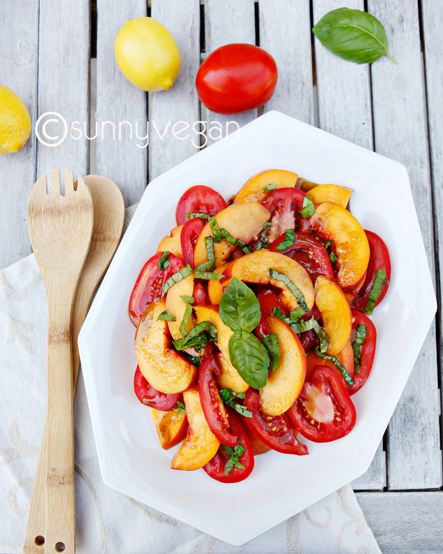 fresh peach tomato salad vegan with lemon and basil